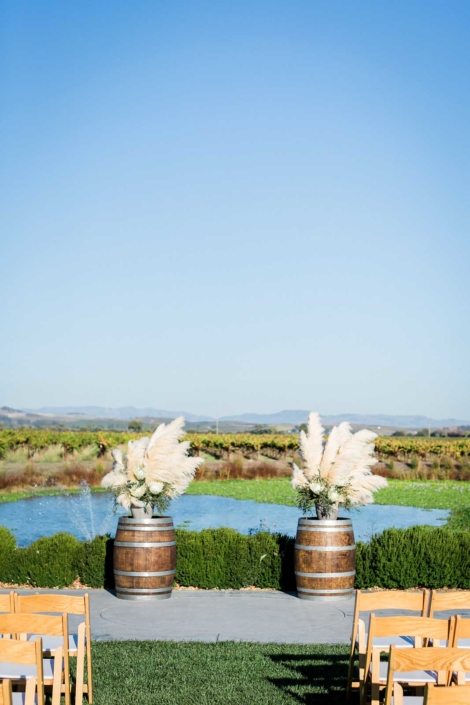 Wine Barrels & Delta Grass with the Carneros in the Background set a Stunning Ceremony Site - Brian & Jon at Tyge Williams Cellars by Sharon Burns, Napa Valley Custom Events