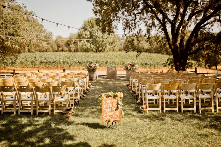 Wine barrels under the +100 year old oak facing the vineyards provides a stunning setting for Brie & Tyler at Arista Winery, Healdsburg, by Sharon Burns, Napa Valley Custom Events