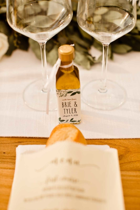 Favors of local Extra Virgin Olive Oil and fresh sourdough for each guest adorn the tables for Brie & Tyler at Arista Winery, Healdsburg, by Sharon Burns, Napa Valley Custom Events